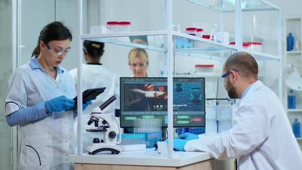 Thumbnail for Scientist Nurse Taking Notes on Tablet in Laboratory
