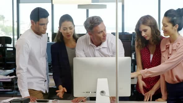Thumbnail for Business people working together on computer at desk in a modern office