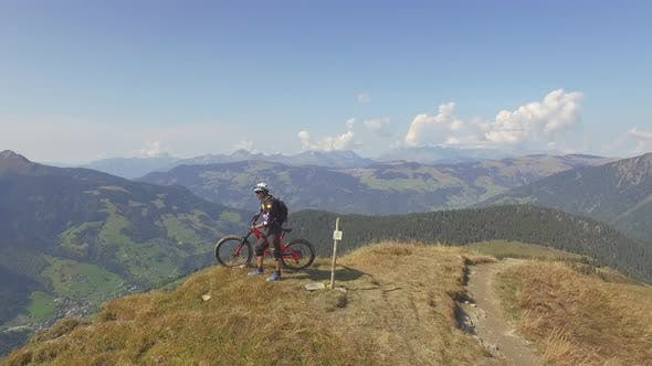 Thumbnail for Aerial drone view of mountain biker biking in the mountains.