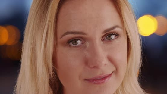 Thumbnail for Extreme close-up of charming Caucasian woman's face alone on bokeh background