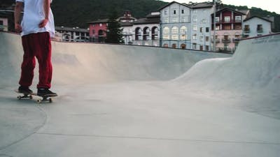 Professional Skateboarder Performing in Bowl Ramp