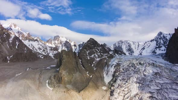 Cover Image for Tian Shan Mountains and Blue Sky with Clouds. Aerial View
