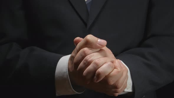 Businessman puts hand on a hand