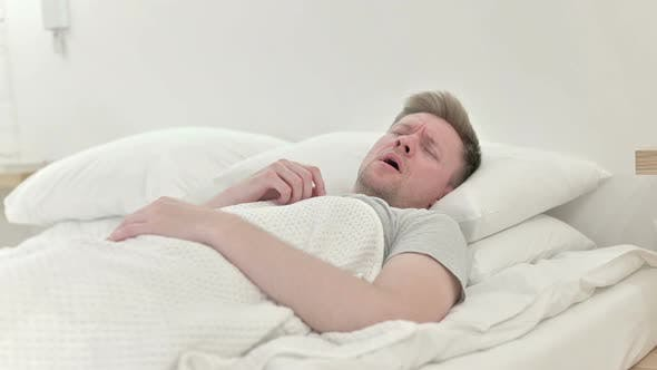 Thumbnail for Long Shot of Man Coughing in Bed