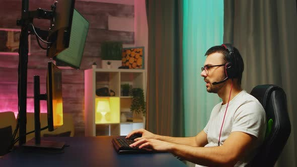 Professional Young Gamer Playing Shooter Games