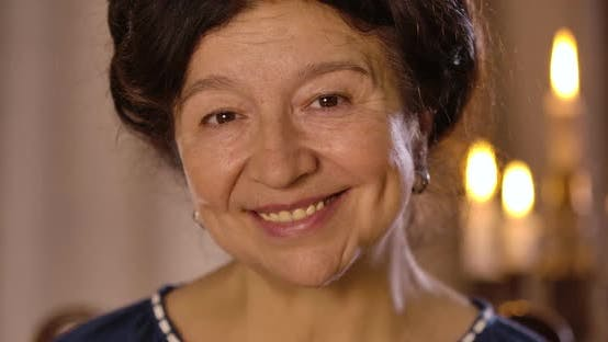 Thumbnail for Close-up Portrait of Smiling Mature Caucasian Woman Looking at Camera and Talking