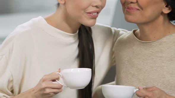 Thumbnail for Adult Sisters Smiling and Talking with Tea Cups, Home Relax Atmosphere, Support