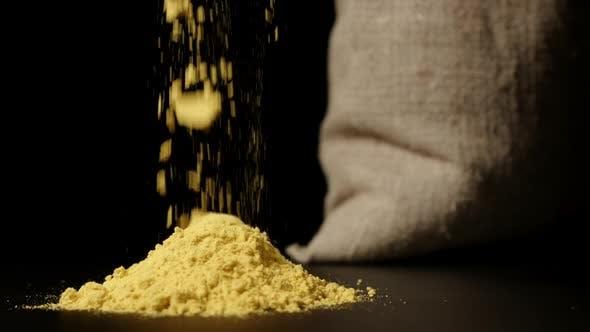 Thumbnail for Turmeric Powder Falling Down Near A Sac