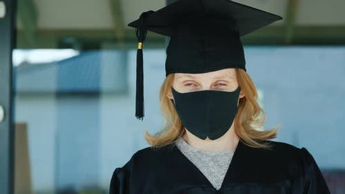 Portrait of a Masked Graduate on the Doorstep of the University