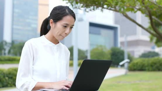 Thumbnail for Young Business Woman Work on Laptop Computer at Outdoor