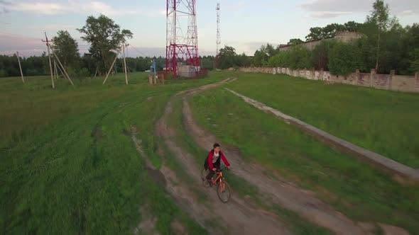 Thumbnail for Aerial View of Boy Riding Bike in the Countryside