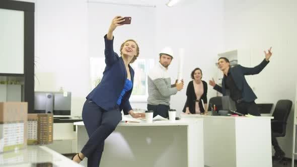 Thumbnail for Slow Motion, Woman Makes Photos with Her Workmates During Working Day