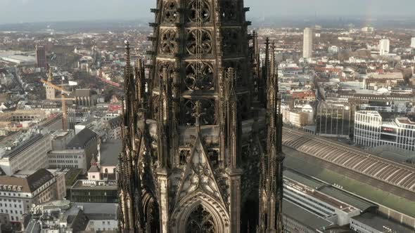 Thumbnail for AERIAL: Super Detail Close Up of Cologne Cathedral Brown Towers in Beautiful Sunlight