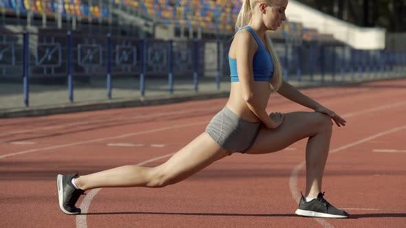 Thumbnail for Female Athlete Doing Gymnastic at Stadium, Preparing Her Muscles for Competition
