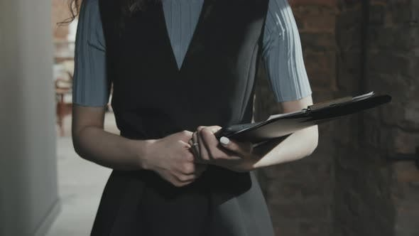 Midsection of Business Woman with Clipboard