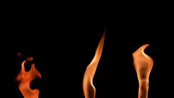 Set of Three Orange Flames in Slow Motion on a Black Background