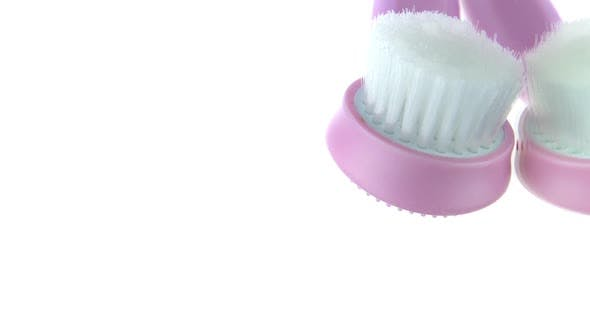 Vertical Video Soft Bristle Hairbrush with Silicone Massager 360 Rotating on Glass Table