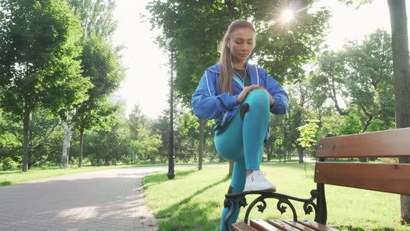 Thumbnail for Attractive Sportswoman Stretching Outdoors in the Park