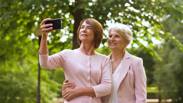 Thumbnail for Senior Women Taking Selfie By Smartphone at Park