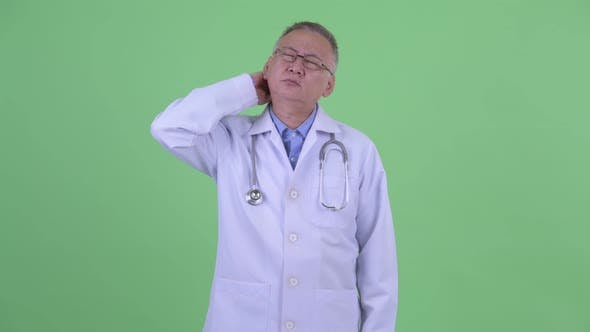 Thumbnail for Stressed Mature Japanese Man Doctor Having Neck Pain