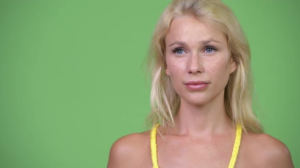 Thumbnail for Young Happy Beautiful Blonde Woman Thinking Against Green Background