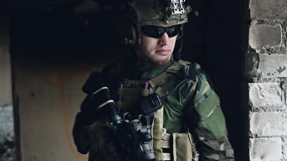 Thumbnail for Close-up Shot of Fully Equipped Soldier Standing Inside the Building