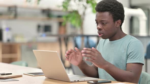 Thumbnail for Loss, Young African Man Reacting To Failure on Laptop