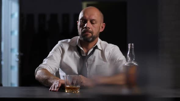 Thumbnail for Depressed Adult Businessman Drinking Whiskey