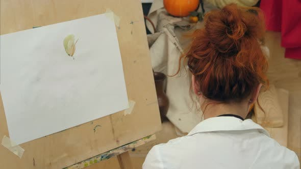 Thumbnail for Young Female Artist Painting Watercolor Picture in Studio