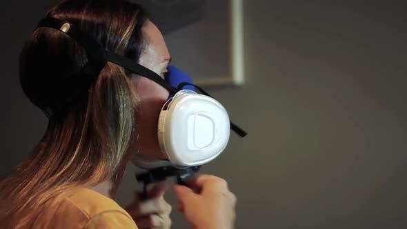 Woman wearing Respiratory Mask to Protect from Coronavirus.