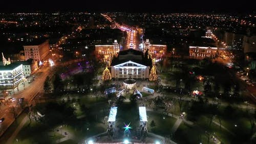New Year's lighting in the city square. Aerial view.