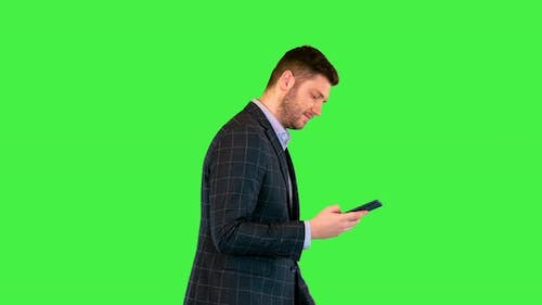 Businessman Boss Walk Focused on Message in Smartphone Texting or Browse Internet with Mobile Phone