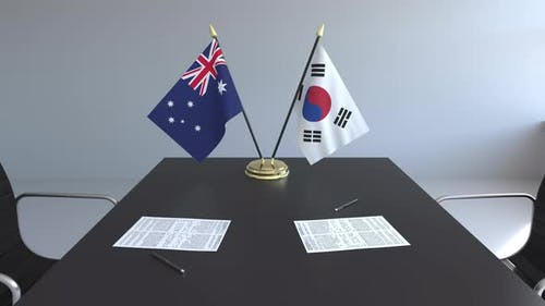 Flags of Australia and South Korea and Papers