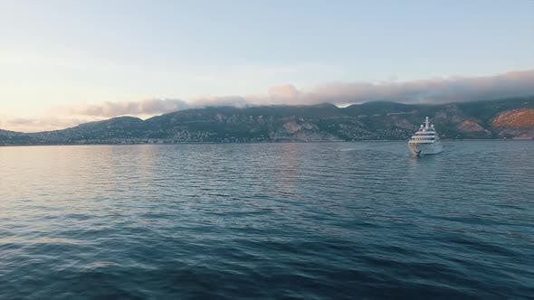 South of France sea view with large private luxury yacht and chase boat underway. Super yacht