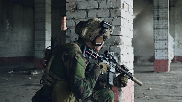 Soldier Pull in an Ammunition Clip Into Assault Rifle, Moving in Abandoned Building To Clear the