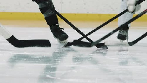Hockey Players Tapping Sticks On Ice