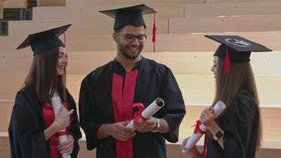 Multiracial Students Waiting for Graduation Ceremony