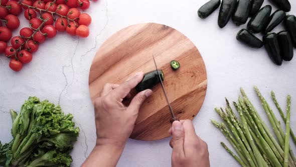 Cutting Jalapeno Peppers on Chopping Board