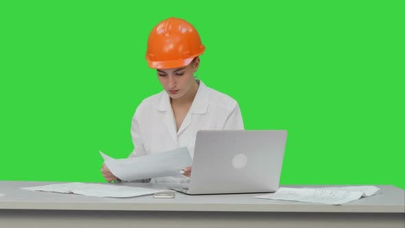Thumbnail for Young Engineer Woman Reading Technical Drawings on a Green Screen, Chroma Key