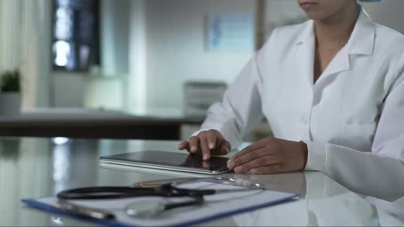 Thumbnail for Female Doctor Scrolling Tablet Screen, Checking Patients Test Results, Clinic