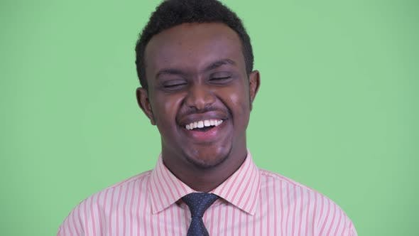 Face of Happy Young African Businessman Smiling and Laughing
