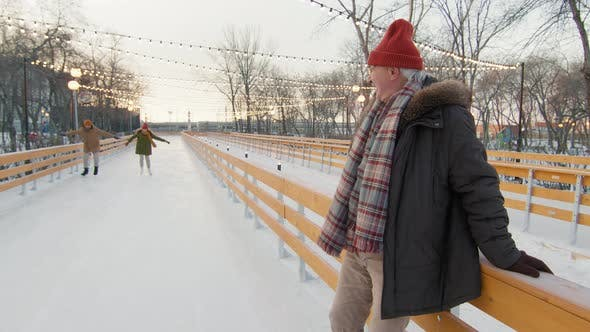 Thumbnail for Senior Man Watching Couple Skating