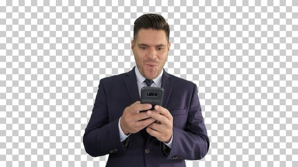 Businessman looking at smartphone with surprise expression