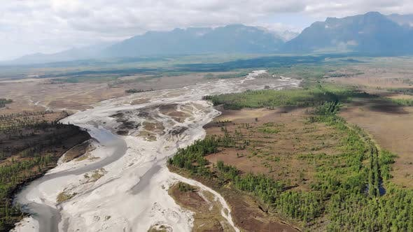 Thumbnail for Drone Flies Over the Sakukan River, Mountains in the Background