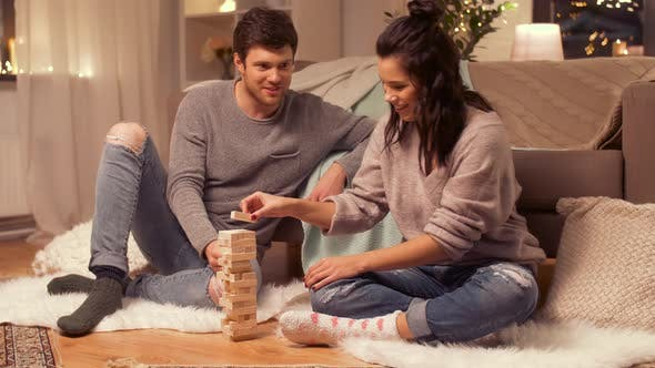 Thumbnail for Happy Couple Playing Block-stacking Game at Home