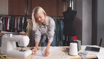 Dressmaker Working with Measuring Tape