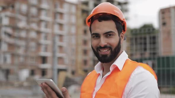 Thumbnail for Portrait of Construction Worker on Building Site with Tablet Looking at the Camera