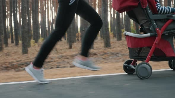 Woman Running with a Baby Stroller