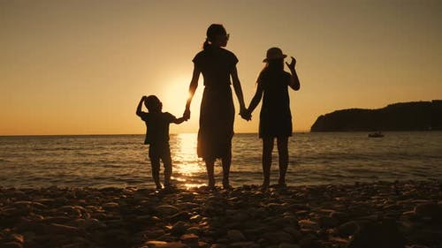 Happy Family Mother with Two Children on Vacation at the Beach