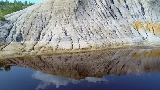 Thumbnail for Camera Moves Along Slope Sky Reflection in Blue Lake on Pit